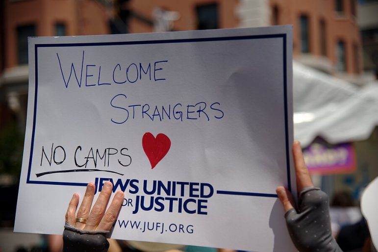 sign reading welcome strangers no camps